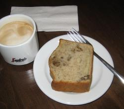 Cup of cappuccino and slice of banana-nut-bread