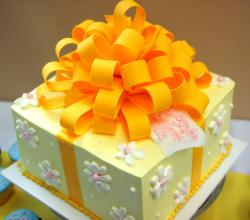 Decorative cake with large orange bow