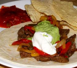 Fajita with sauteed onion and sour cream