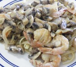 Fettuccine with mushroom-cream and shrimp sauce