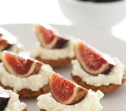 Fig tarts with whipped cream on a plate