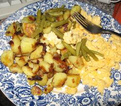 Fried potatoes with scrambled eggs and beans