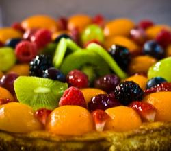 Fruit tart with kiwi, peach, and raspberry