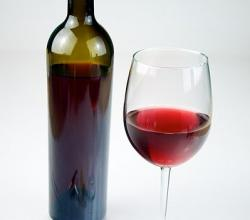 Glass of Red Wine with a bottle of Red Wine