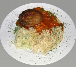 Jaeger schnitzel with smoked sausage and tomato sauce