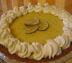 Key lime pie with whipped cream and lime