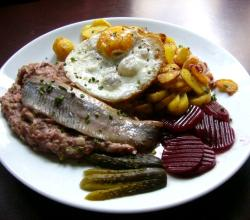 Labskausgericht with fried potatoes and herring