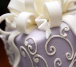 Lavender wedding cake with cream white swirls