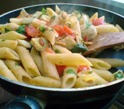 Penne with tomato, artichoke, basil and pine nuts