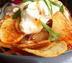 Potato with sour cream and chili sauce