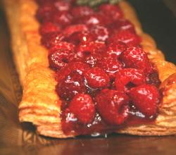 Puff pastry covered with raspberries