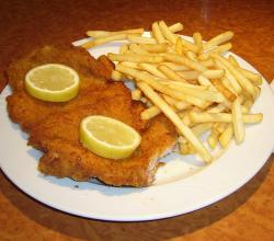 Schnitzel with French fries and lemon