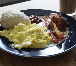 Scrambled eggs, bacon, ciabatta and caffe latte