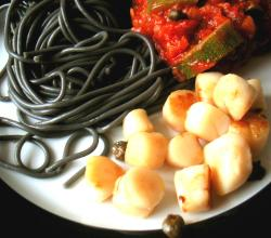 spaghetti with squid and tomato sauce with zucchini
