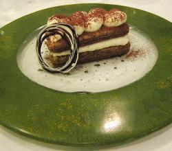 Tiramisu on a speckled green plate