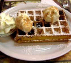 Waffle with ice cream and whipped cream