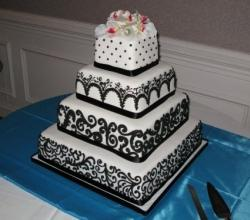 Four Tier Wedding Cake - Black and White with Colorful Flowers