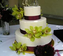 Wedding cake with green floral decoration