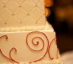 wedding cake with red swirls