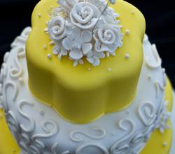 Yellow Wedding Cake with White Roses