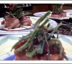 Bacon Wrapped Pork Tenderloin with Leek Sauce Red Onion Puree and Grilled Asparagus