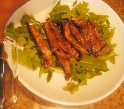 Raw Teriyaki Mushrooms Over Arugula