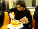 Artist Frosts A Cake On NYC Subway