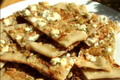 How To Make Pumpkin Seed Flatbread Topped With Sweet Onions And Feta