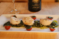 Scallops On Pesto Sauce And Stuffed Cherry Tomatoes