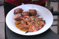 Plank Grilled Salmon Shrimp and Scallops Wrapped in Prosciutto