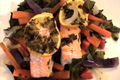 Salmon in Parchment on a Bed of Greens with Julienne Root Vegetables