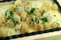 Sizzling Potatoes in Cheese Sauce by Tarla Dalal