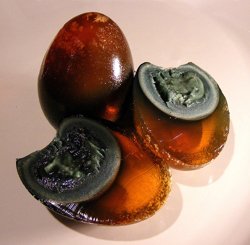 Century Eggs with a deep brown egg whites and beautiful patterns.