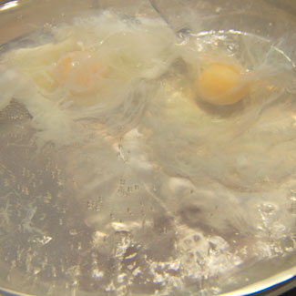 Tips on how to poach an egg when slowly dropped in boiling water.