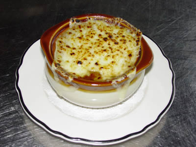 Eating chopped onions in a yummy baked onion soup