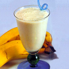 Making a delicious banana smoothie with added fruits and vanilla