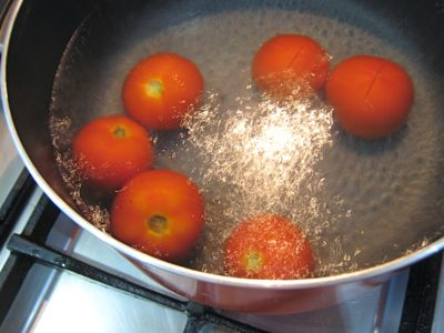 Tomatoes boiling in the process of preserving them