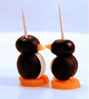 Cream cheese penguins with black olives is a great winter appetizer