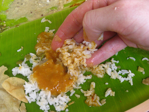 When eating rice with fingers use your thumb to push the morsel into your mouth