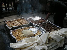 A hangi meal being prepared