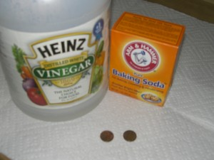 Use vinegar and baking soda to clean commercial cooking pots