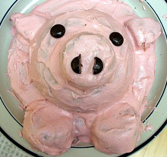 Use lot of pink butter for decorating a pig cake