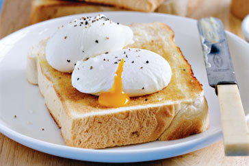 eating poached eggs