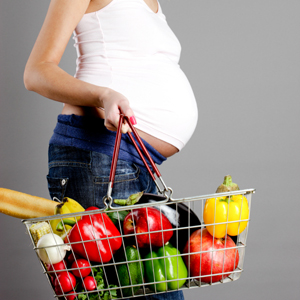 Pregnant woman carrying vegetables