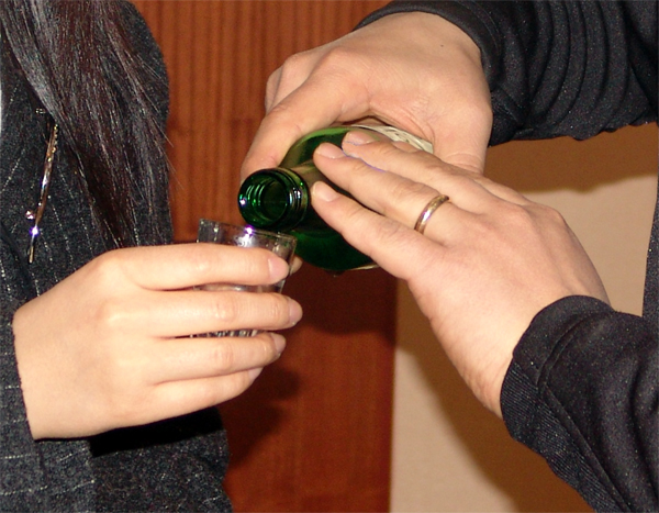 Hold the bottle with both hands when offering drinks