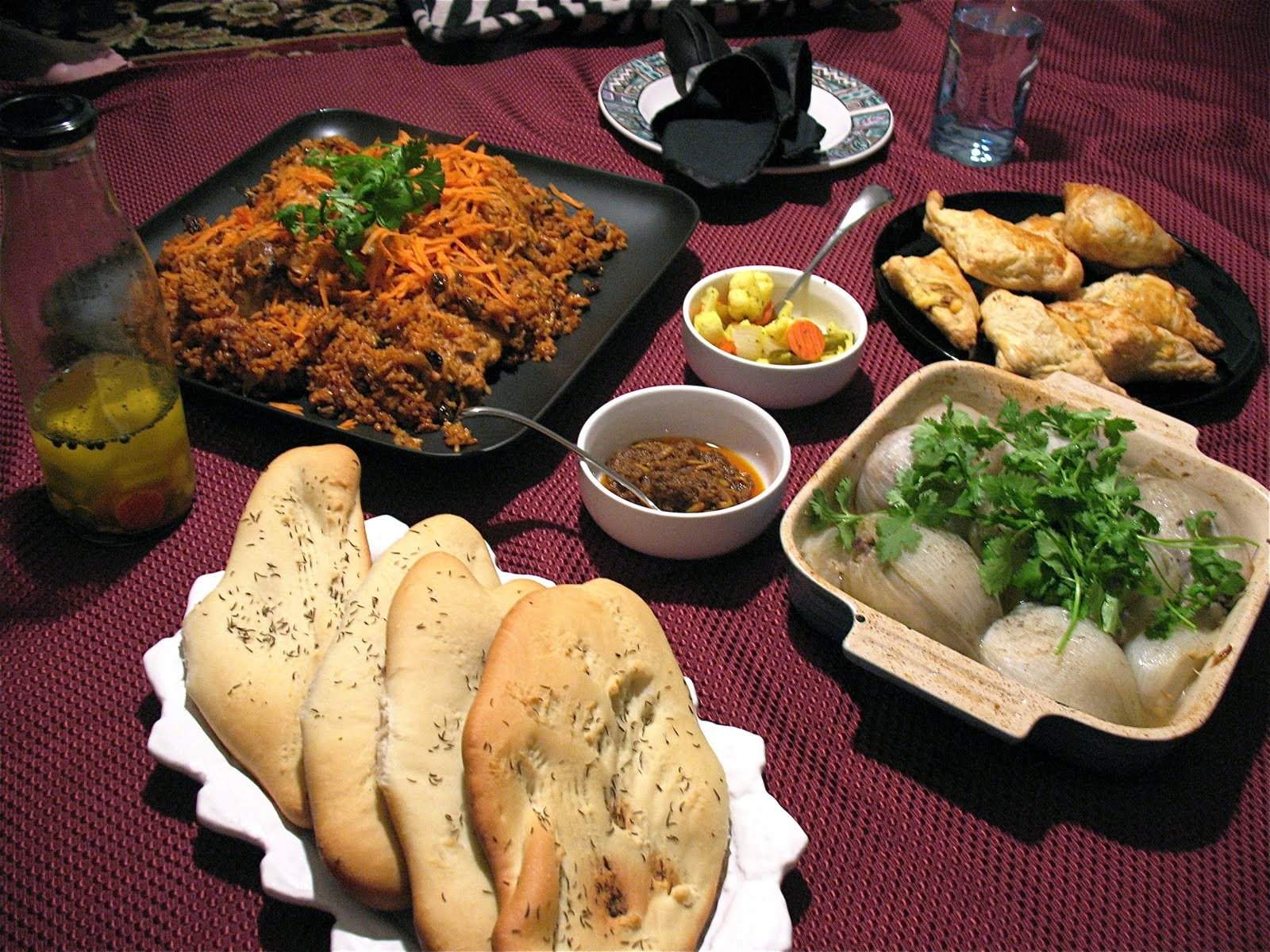 A traditional Afghan Table spread or Dastarkhan, with Osh Pyozee served at bottom right