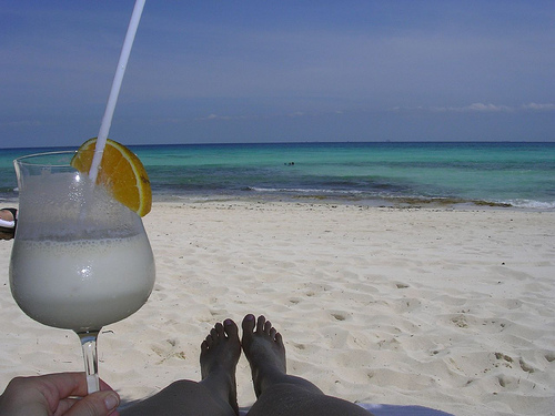 Enjoying Pina colada at the beach