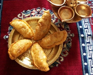 Assorted Karanjias for Diwali - Sweet Stuffed Fried Dumplings picture