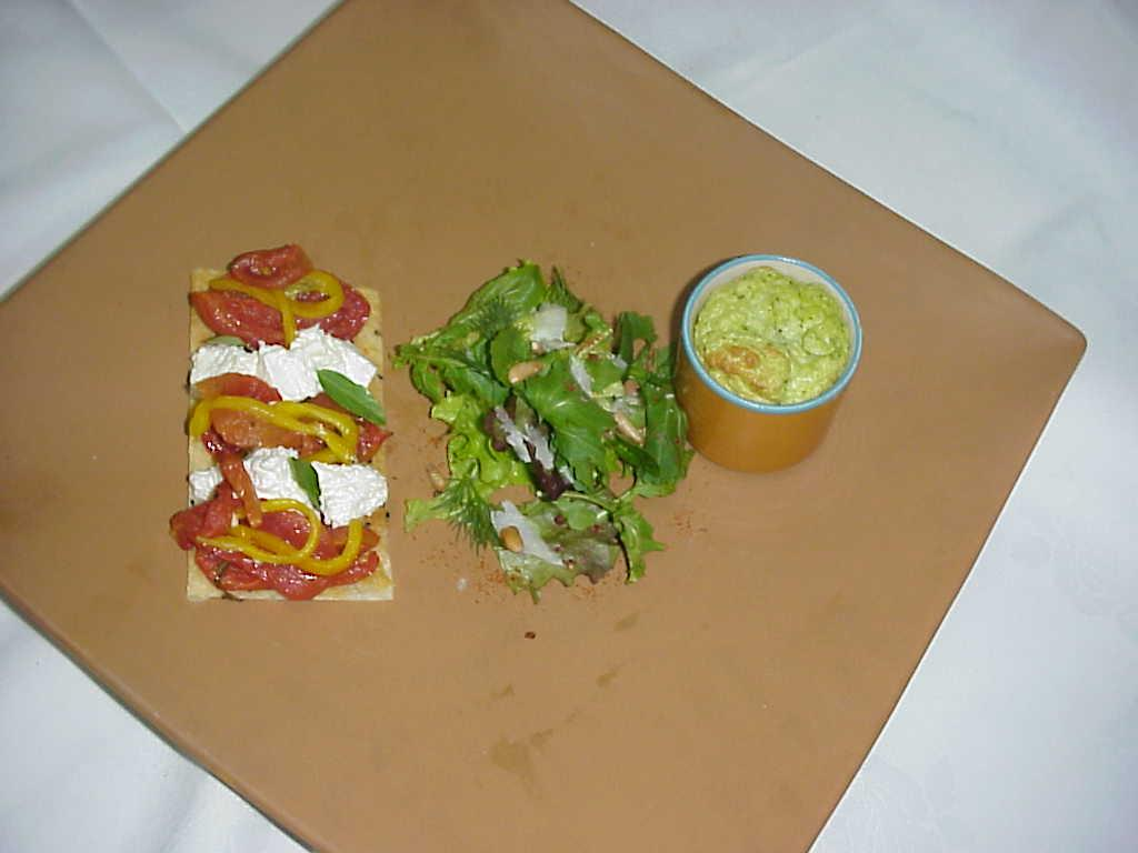 Millefeuille of tomato ,goat cheese with zucchini souffle picture