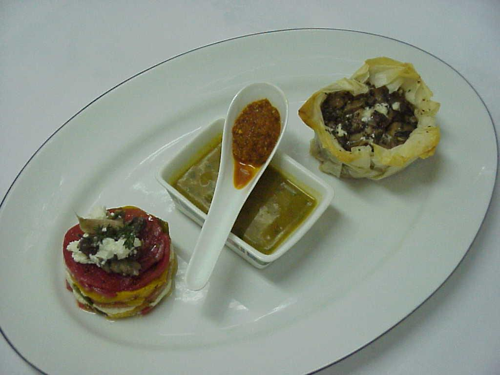 Marinara served with mushroom ragout filled in phyllo baskets and tian of goat cheese and peppers picture